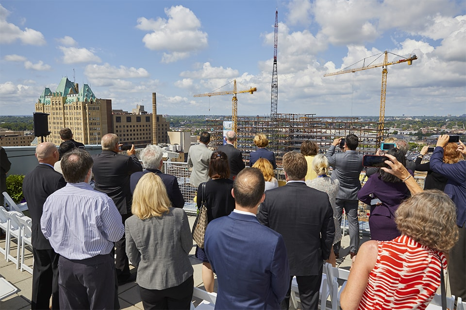 The final beam that forms the skeleton of the new SSM Health Saint Louis University Hospital was hoisted into place Thursday, as SLU and SSM Health commemorated a construction milestone on the academic medical campus.