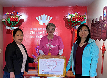 (Right) SLU professor Donghua Tao, Ph.D., and another volunteer present a donation of 2,000 masks to a staff member at SSM Health Cardinal Glennon Children's Hospital (center).