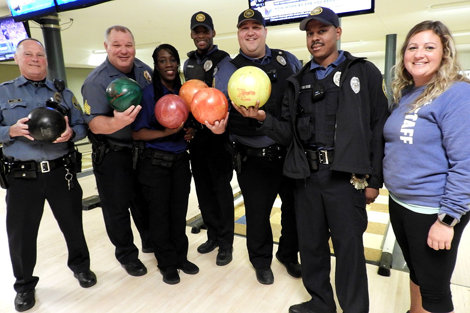 Officers with SLU's Department of Public Safety (DPS) help out with a bowling competition for Special Olympics Missouri.