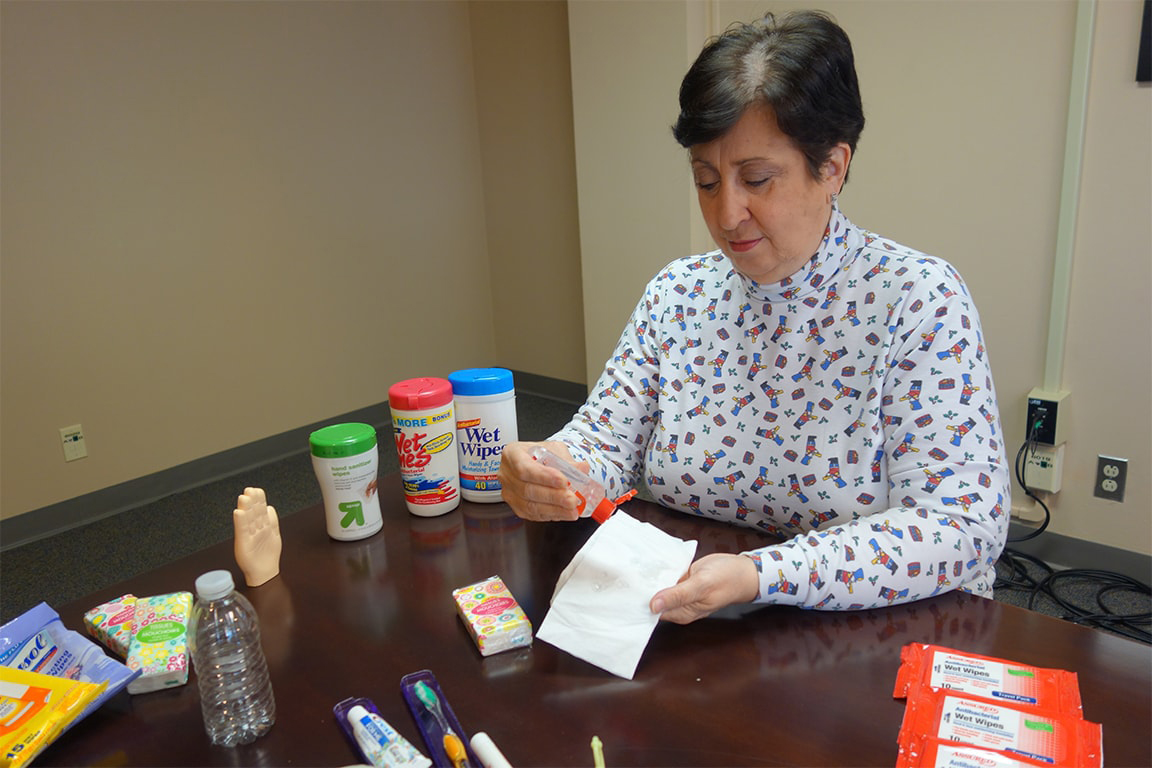 Donna Duberg, assistant professor of biomedical science, shows how to make travel wipes out of hand sanitizer and a tissue.