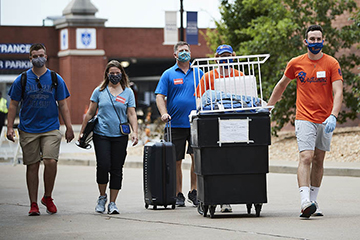 Members of the student leadership group, Oriflamme, assist new residential students and their families during the fall 2020 move-in.