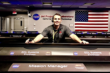 Fernando Abilleira poses for a photo in mission control at NASA's Jet Propulsion Laboratory.