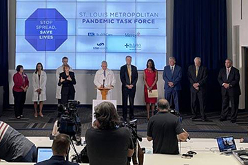 A photo of the  St. Louis Metropolitan Pandemic Task Force's final COVID-19 media briefing on the campus of Saint Louis University