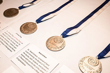 Medals presented to the honorees at the first SLU University-wide Investiture Ceremony
