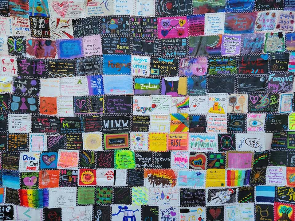 """The Justice Fleet """"Radical Forgiveness"""" art exhibit was displayed at the Busch Student Center Amphitheater on Friday, Sept. 24, as part of the University's day dedicated to self care and reflection."""