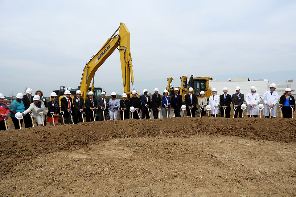 Fred P. Pestello and other dignitaries break ground on the new hospital.