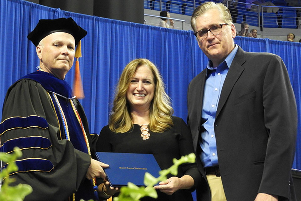 Mark Higgins, Ph.D.,  Edward Jones Endowed Dean of the Richard A. Chaifetz School of Business, poses with Denise and Bob Gruensfelder.