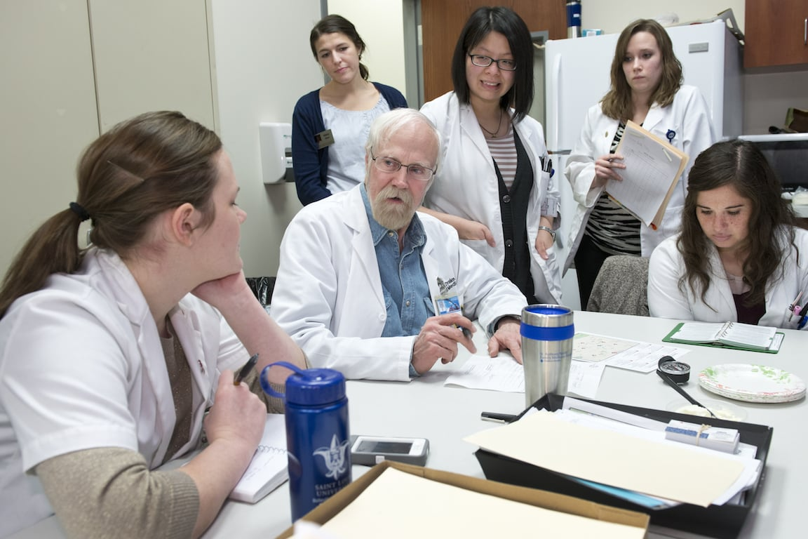 Students review cases with Dr. James R. Drake, professor of internal medicine and HRC faculty volunteer