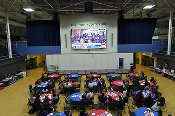 Students gather to watch the Iowa caucuses together in a watch party planned by political science faculty members.