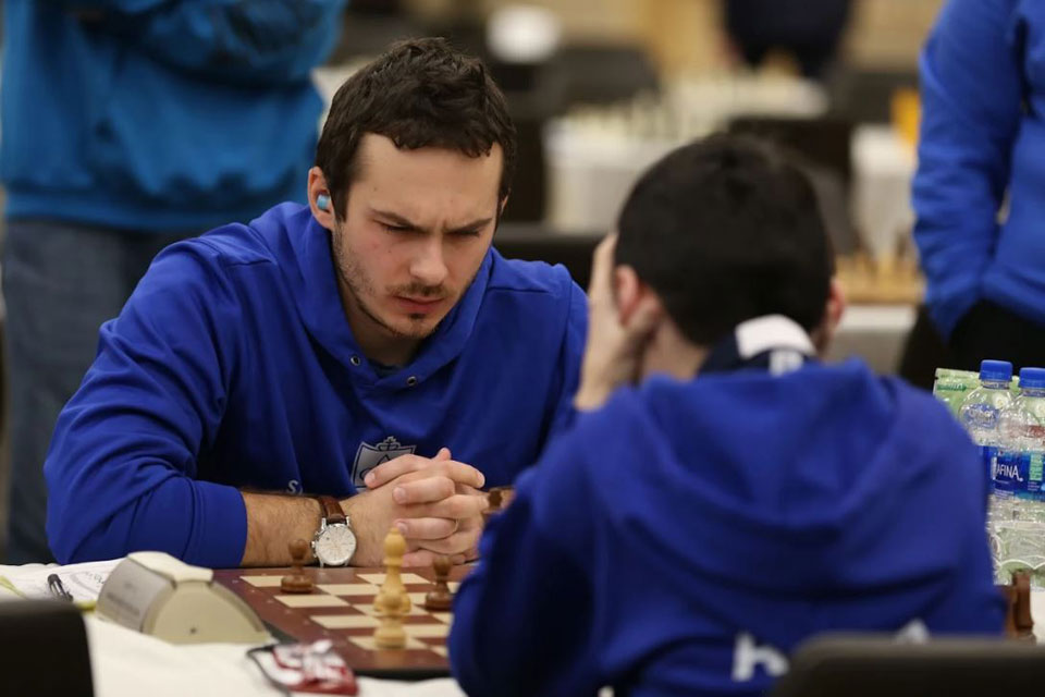 SLU chess player Oleksandr Ipatov contemplates a move.