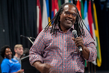 The late Jonathan Smith, Ph.D., addresses students during an Oath of Inclusion event in Chaifetz Arena.