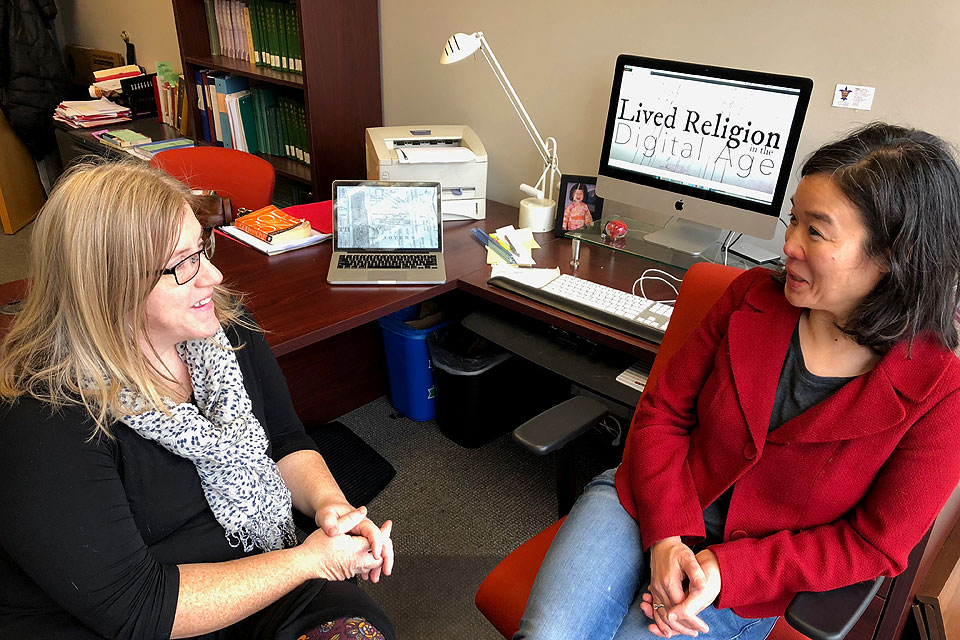 From left, Rachel Lindsey, Ph.D., assistant professor, and Pauline Lee, Ph.D., associate professor, both in SLU's Department of Theological Studies, were highlighted in STLMade for their digital mapping of religious life in St. Louis. Photo by Amelia Flood.