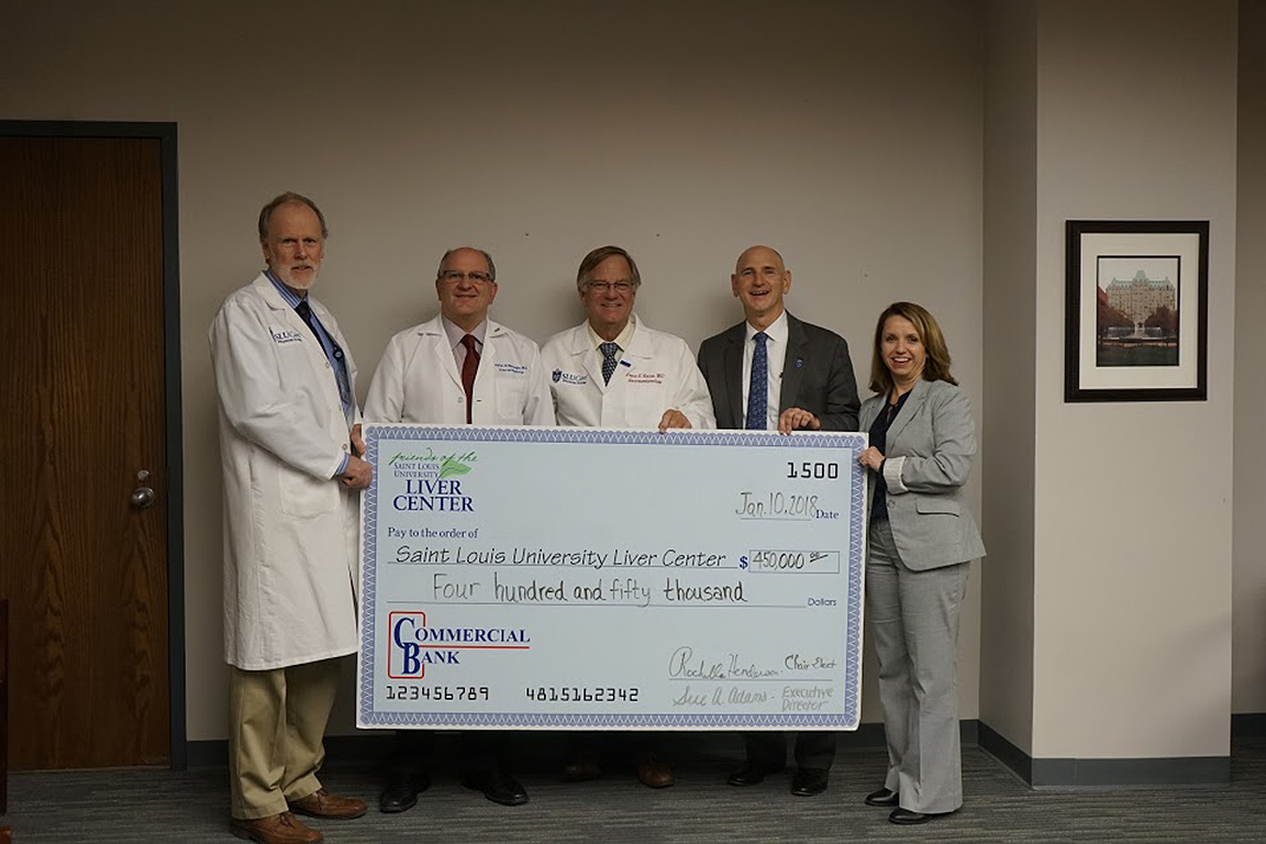Friends of the SLU Liver Center present a check