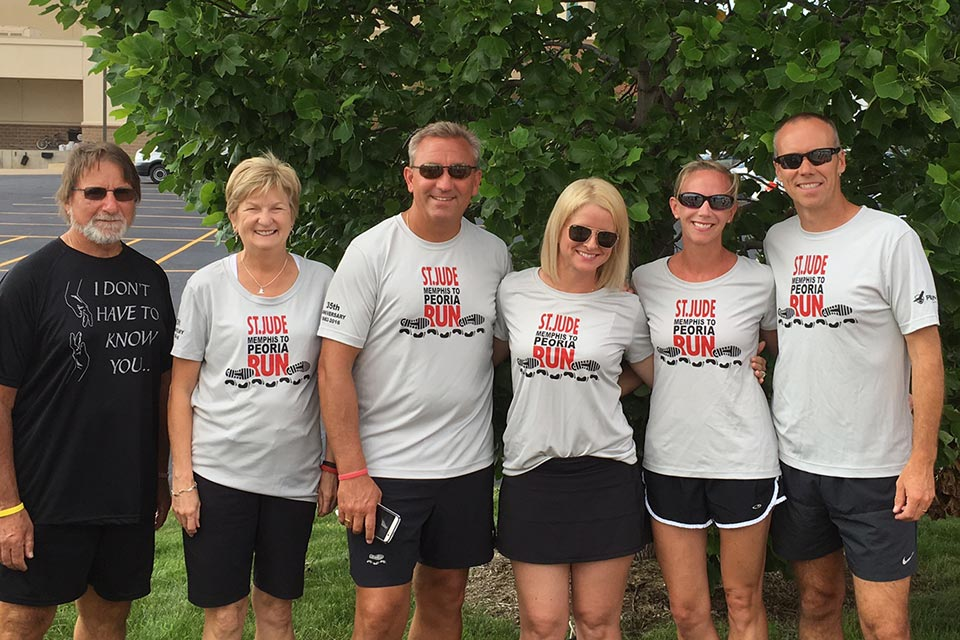 Mardell Wilson, Ed.D. (second from right) and her husband Dave (far right) along with their teammates on the Gold 1 Team each ran segments of the relay from Memphis, Tennessee, to Peoria, Illinois.