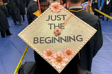 A new graduate's cap at 2019 Midyear Commencement.