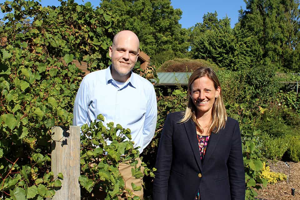 Allison Miller, Ph.D., right, is leading a research team that includes Dan Chitwood, Ph.D., left, and other scientists from institutions throughout the country to study grafting in grapevines. Planned outreach activities include training and educational displays such as this one at the Missouri Botanical Garden.