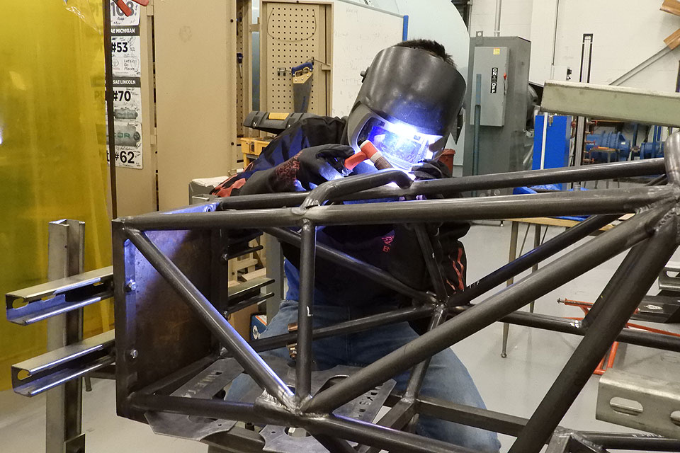 Junior Jacob Bullard welds on the Parks Racing Club's chassis.