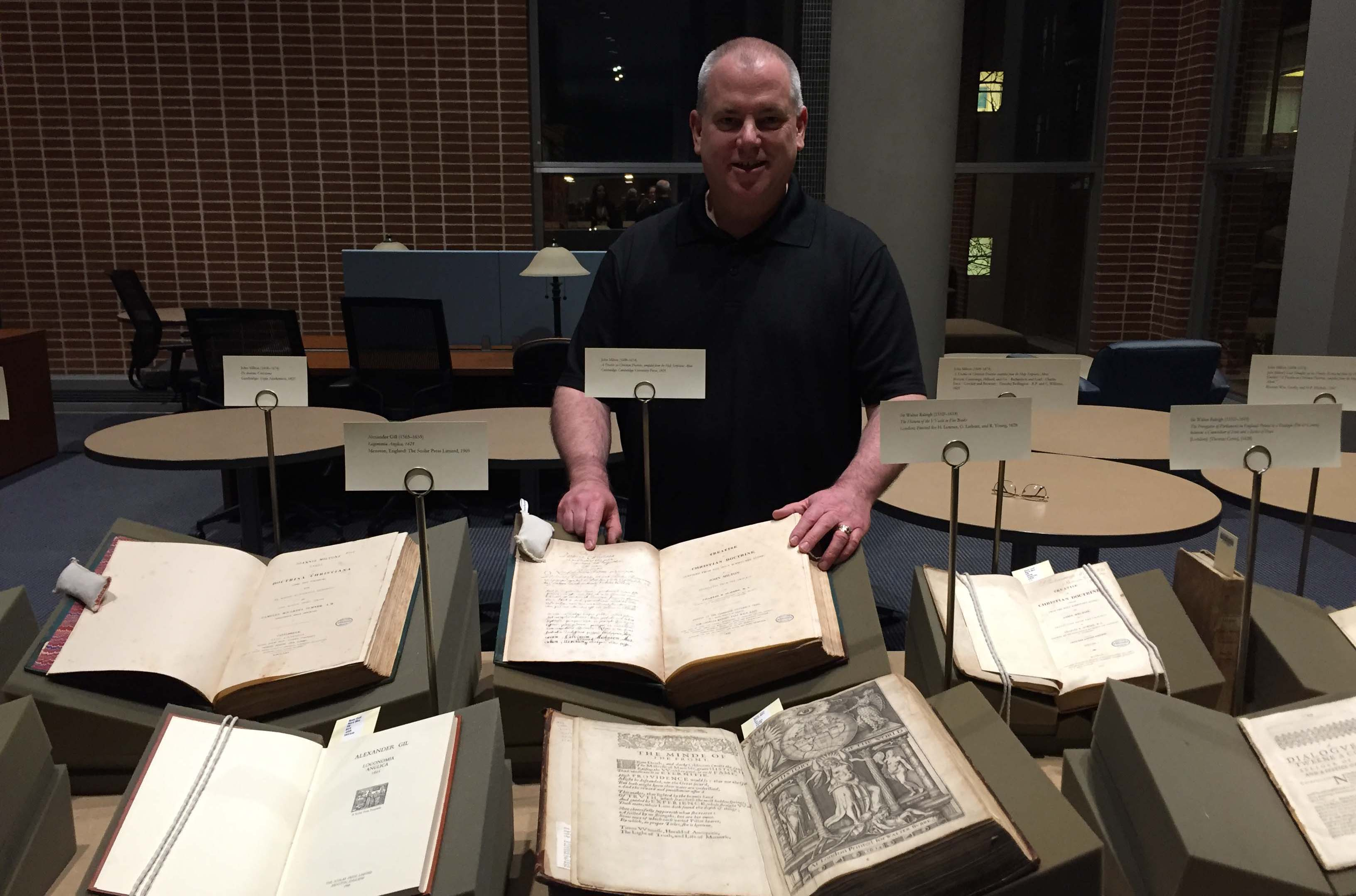 Donor John Geraghty with rare books