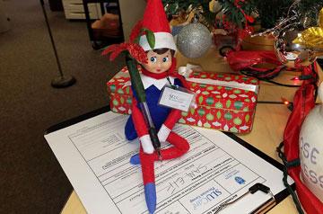 SLUCare's Sam the Elf.