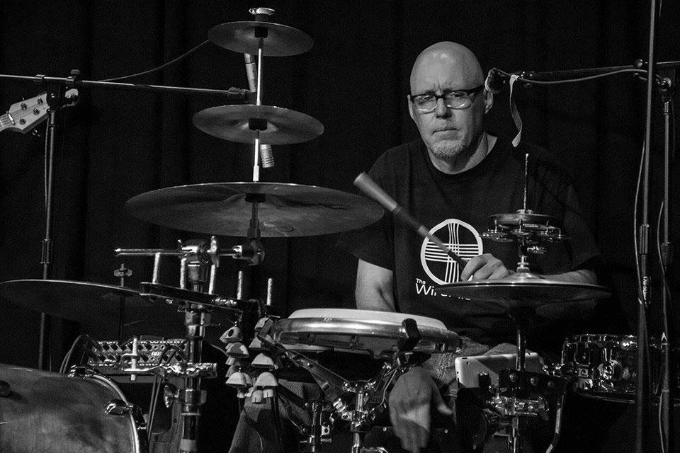 Staff Spotlight: Tech Guru by Day, Drummer, Artist by Night : SLU