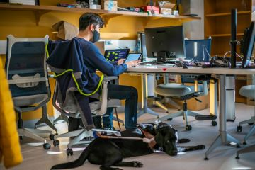 Seyoon Choi with his service dog at the CHROME Lab.