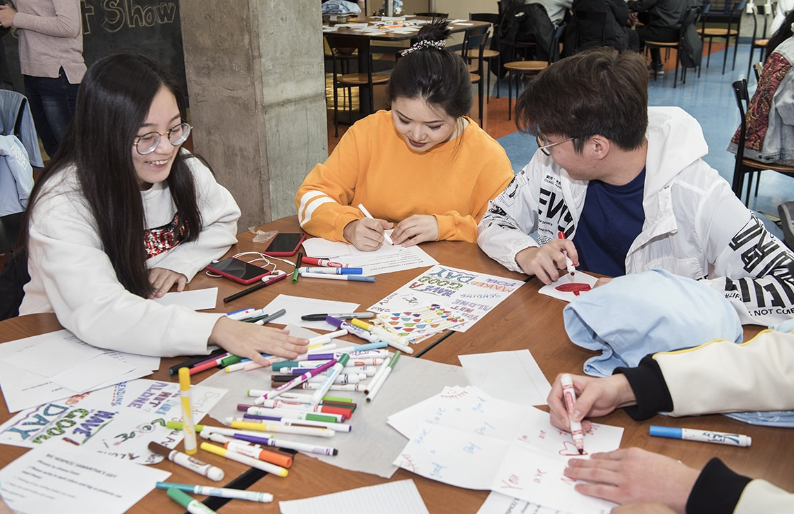 SLU students write cards to hospice patients during the recent Showers of Service event.