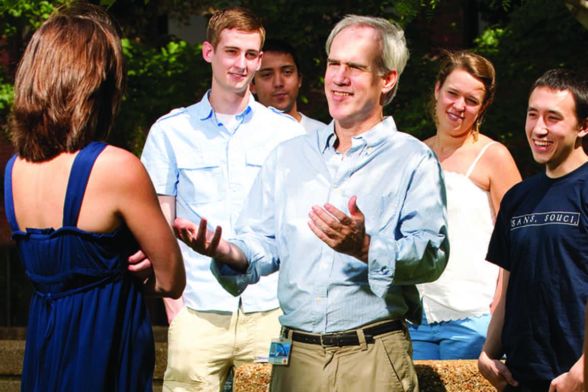 Stuart Slavin, M.D., associate dean of curriculum for Saint Louis University School of Medicine, chats with students.