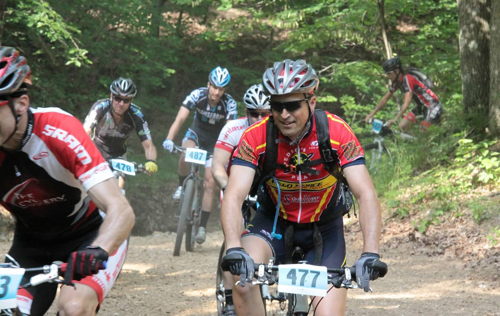 Ted Weiss, Ph.D., associate professor of nutrition and dietetics, turns on the juice as he bikes during a race.