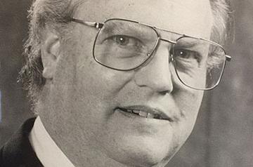 E. Allan Tomey