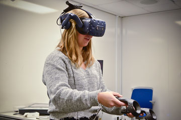 A student uses virtual reality technology.