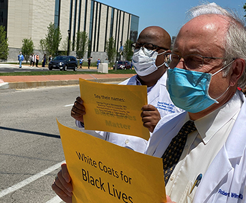 Daniel Blash, Ph.D., chief diversity officer and vice dean of diversity, equity and inclusion and Robert Wilmott, M.D. deand of the School of Medicine, protest Friday, June 12.