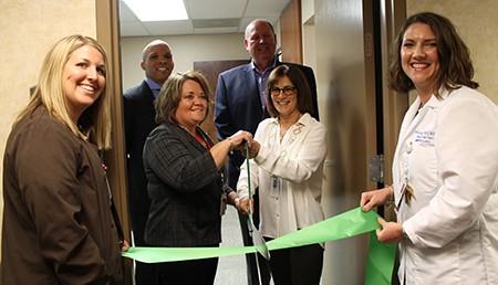 WISH Center opens at SSM Health St. Mary's Hospital. Front row, l-r: Jacqueline Seabaugh, RN, Donna Bernard, Jaye Shyken, MD, Sylvia Poe-Velasco, NP Back row: Travis Capers, President of SSM Health St. Mary's Hospital, Jim Thomson, Mayor of Richmond Heights. Photo by SSM Health St. Mary's