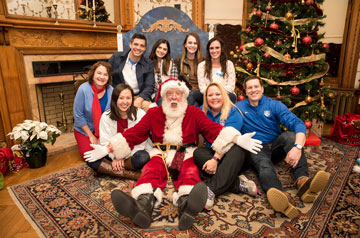 Alumni Office poses with Santa at Christmas on the Quad.