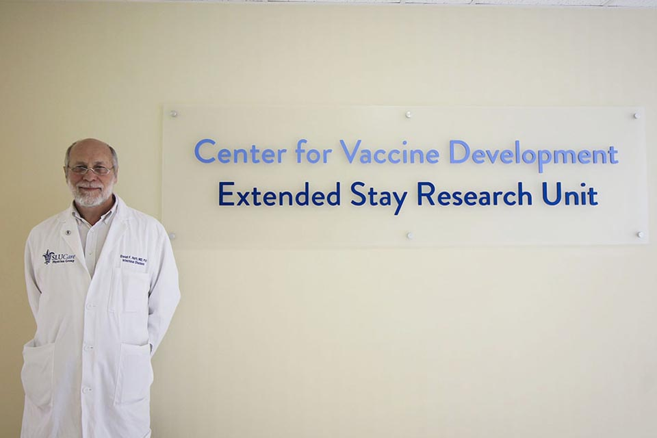 Daniel Hoft, M.D., Ph.D. in front of Center for Vaccine Development Sign