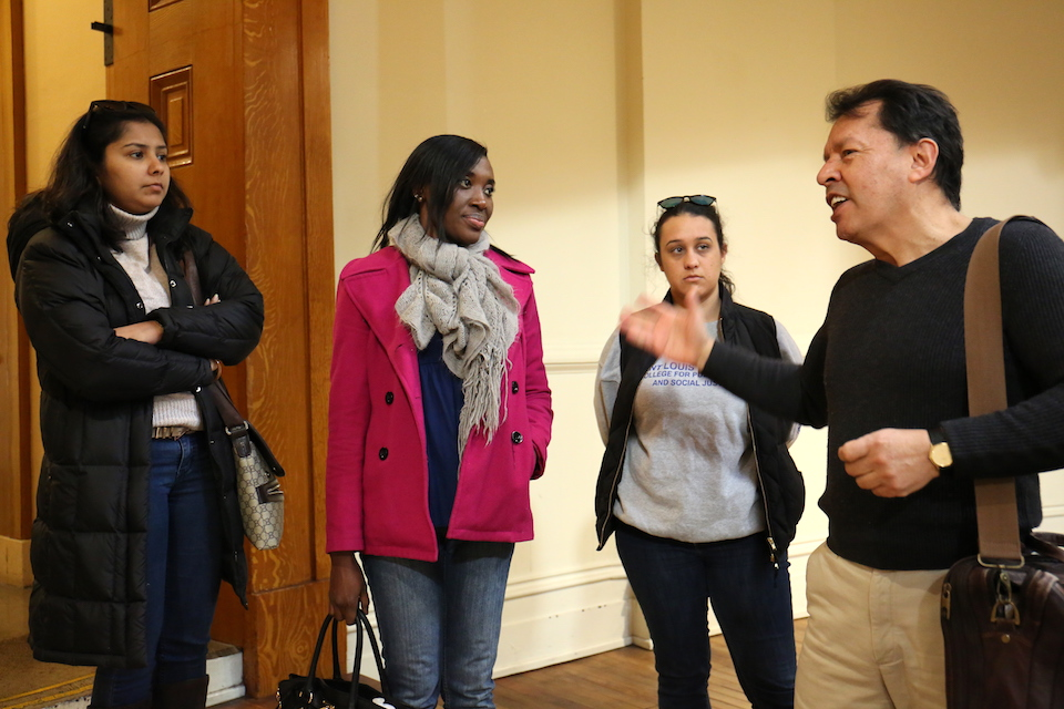 Dr. Fernando Serrano talks to students in the Old Courthouse of St. Louis