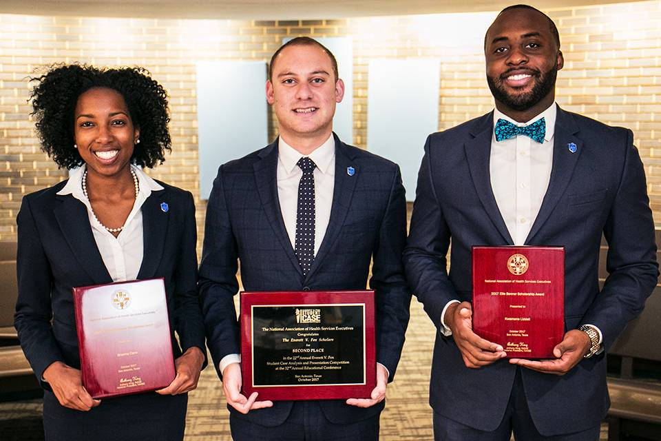 Left to right: Brianna Clare, Matt Glassman and Kwamane Liddell hold their plaques from the NAHSE student case competition.
