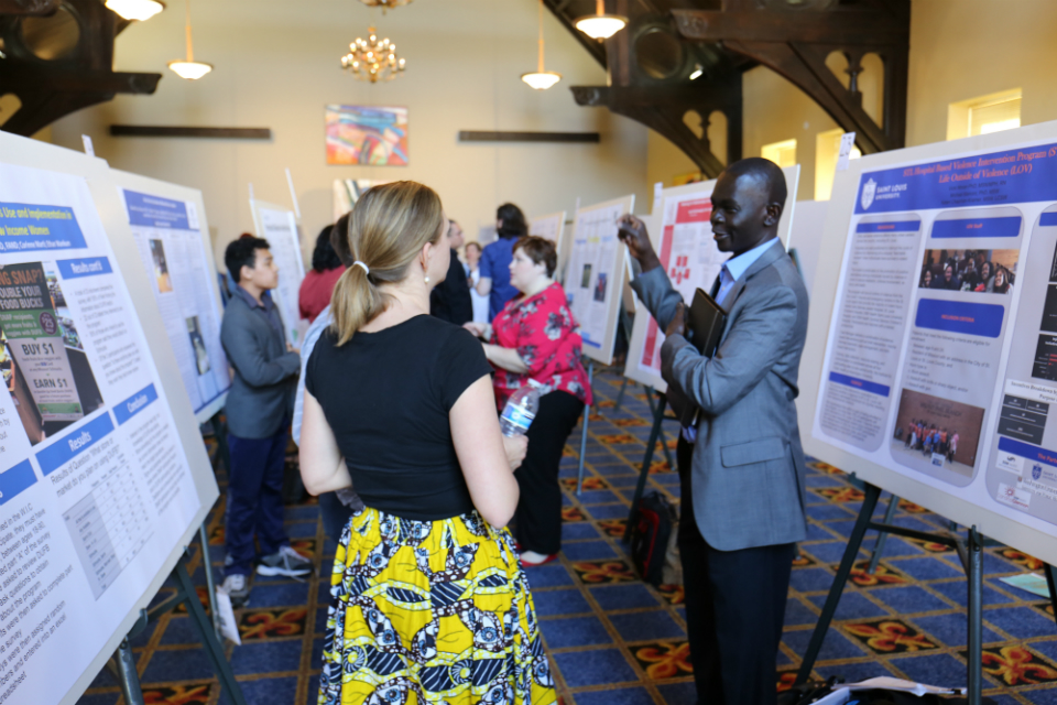 Attendees at the North St. Louis Symposium Poster Session event