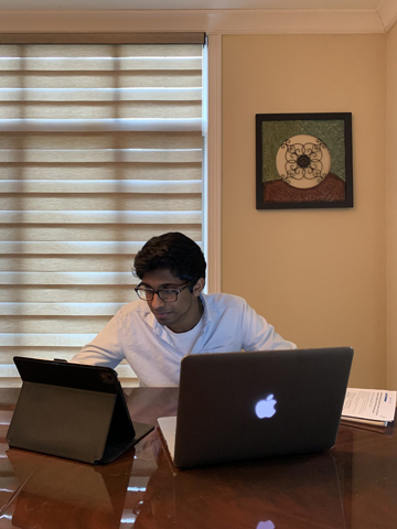 Jensen Vayalil studies at the dining room table in his family's suburban Chicago home.