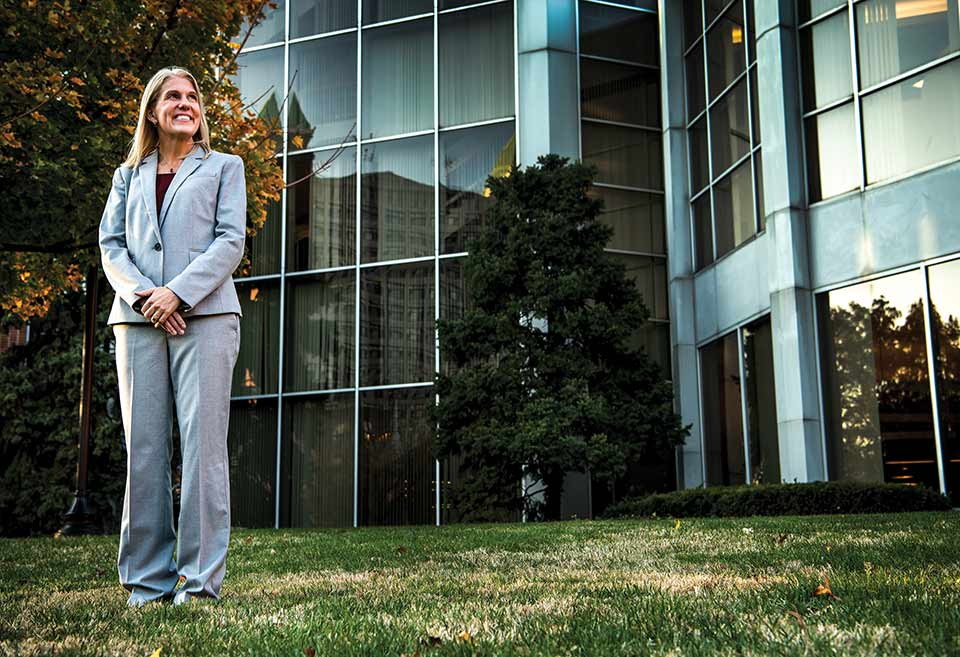 Terri Rebmann, Ph.D., standing on SLU's campus